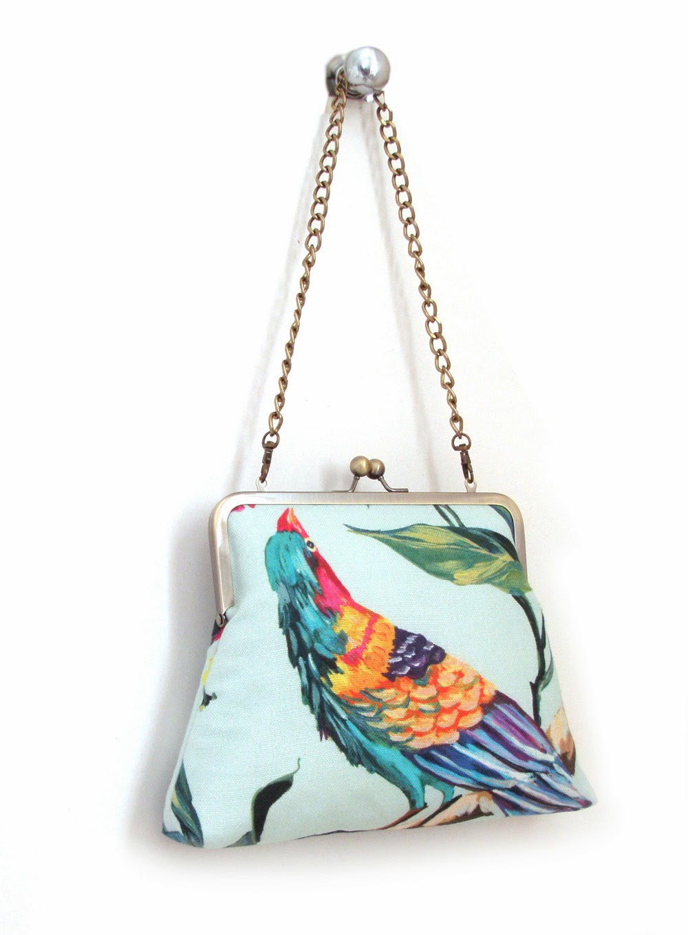 95f75bfb7f ... new shoulder larger clutch bags. Featuring a jewel-like print of  tropical birds on both sides