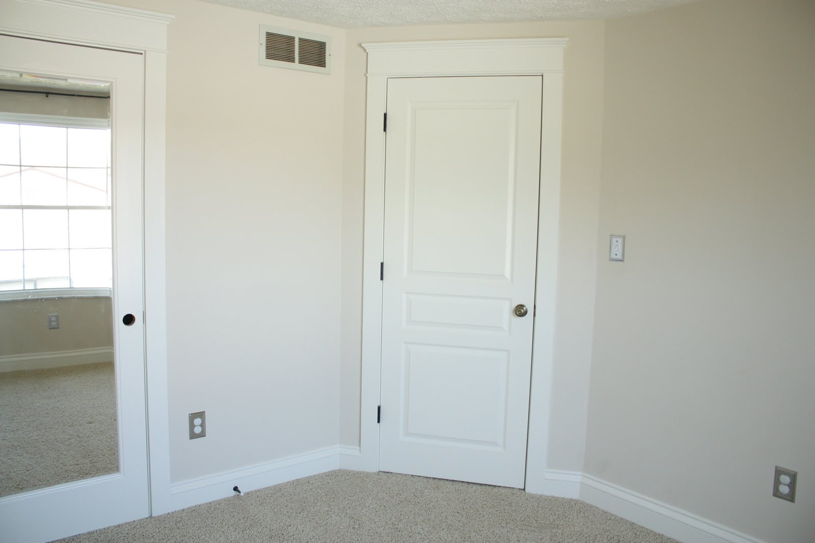 white bedroom doors that one outlet cover is white