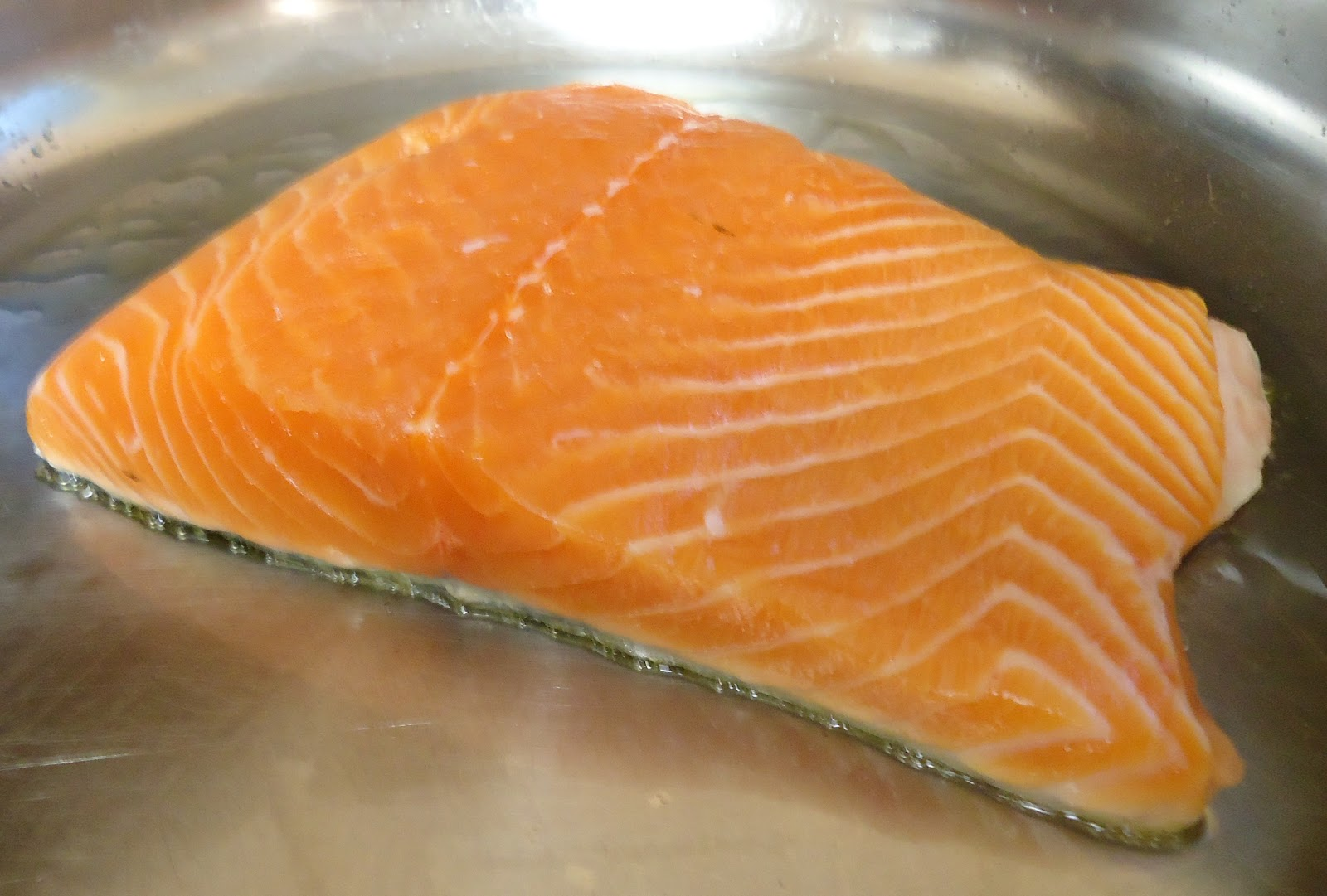 Flip Salmon Onto A Plate Skin Side Up I Use A Thin Stainless Steal Spatula  But You Could Also Use A Butter Knife Or Some Other Thin Metal Utensil