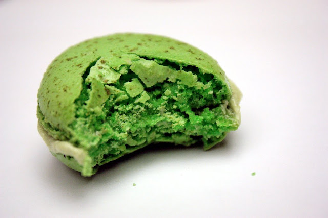bite out of the Pistachio French Macaron