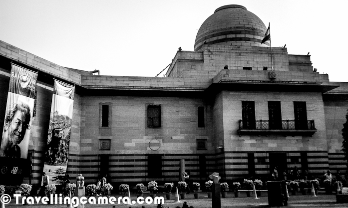 Recently we planned to visit National Gallery of Modern Art for witnessing an outstanding exhibition of Delhi Photographs under name - 'DAWN UPON DELHI - The Rise of Capital' by Alkazi Foundation for the Arts ! This PHOTO JOURNEY share some view of National Gallery of Modern Arts, which is near to India Gate in Delhi ...Since Photography inside the exhibition halls was not allowed, this PHOTO JOURNEY is mainly focus on outer part of the galley campus which is itself very big and well maintained. In fact, we were really impressed by looking at the interiors of Art Galleries and the place where ART-SHOP is located. Everything looks amazing and meets international standardsWhole campus has an artistic feel and inside National Gallery of Modern Arts, we don't feel like being in Delhi... There are many such places in Delhi but this is again a wonderful place ! Most of the gardens of National Gallery of Modern Arts have various sculptures created by famous Indian Artists. Above photograph shows some of the sculptures lying in main garden of the Gallery, which is near to main entry gate.The National Gallery of Modern Art (NGMA) is the leading Indian art gallery. The main museum at New Delhi was established in 1954 by the Government of India, with subsequent branches at Mumbai and Bangalore. Its collection of more than 14,000 works includes artists such as Thomas Daniell, Raja Ravi Verma, Abanindranath Tagore, Rabindranath Tagore, Gaganendranath Tagore, Nandalal Bose, Jamini Roy, Amrita Sher-Gil as well as foreign artists, apart from sculptures by various artists. Some of the oldest works preserved here date back to 1857.National Gallery of Modern Arts is situated at the end of Rajpath, facing the India Gate, the building was a former residential palace of the Maharaja of Jaipur, hence known as 'Jaipur House'. It was designed by Sir Arthur Bloomfield, after the construction of Lutyens' Delhi, in 193This was the Gallery hall where Exhibition of Old Delhi was going on and ser