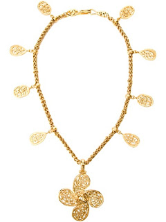 Vintage gold Chanel charm necklace with large flower center charm