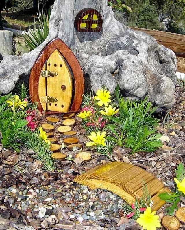 garden design ideas for small gardens magic forest fairies with small tree trunk. small garden design in rathfarnham dublin 14 owen chubb garden