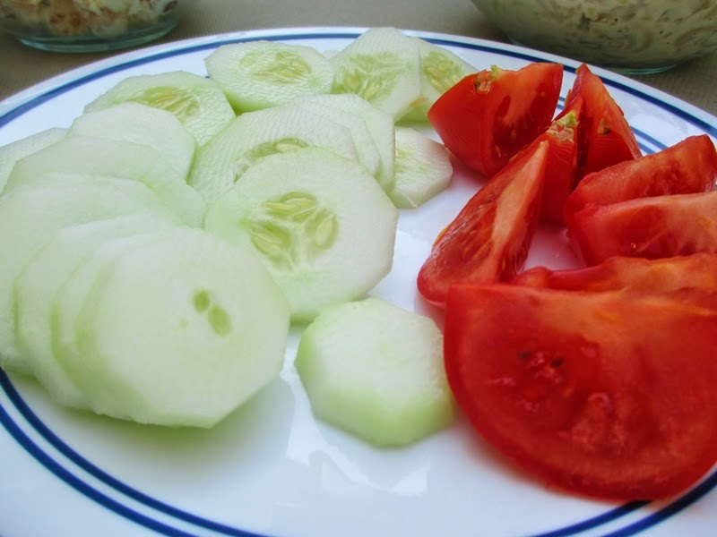 Plate of sliced cucumbers and tomatoes
