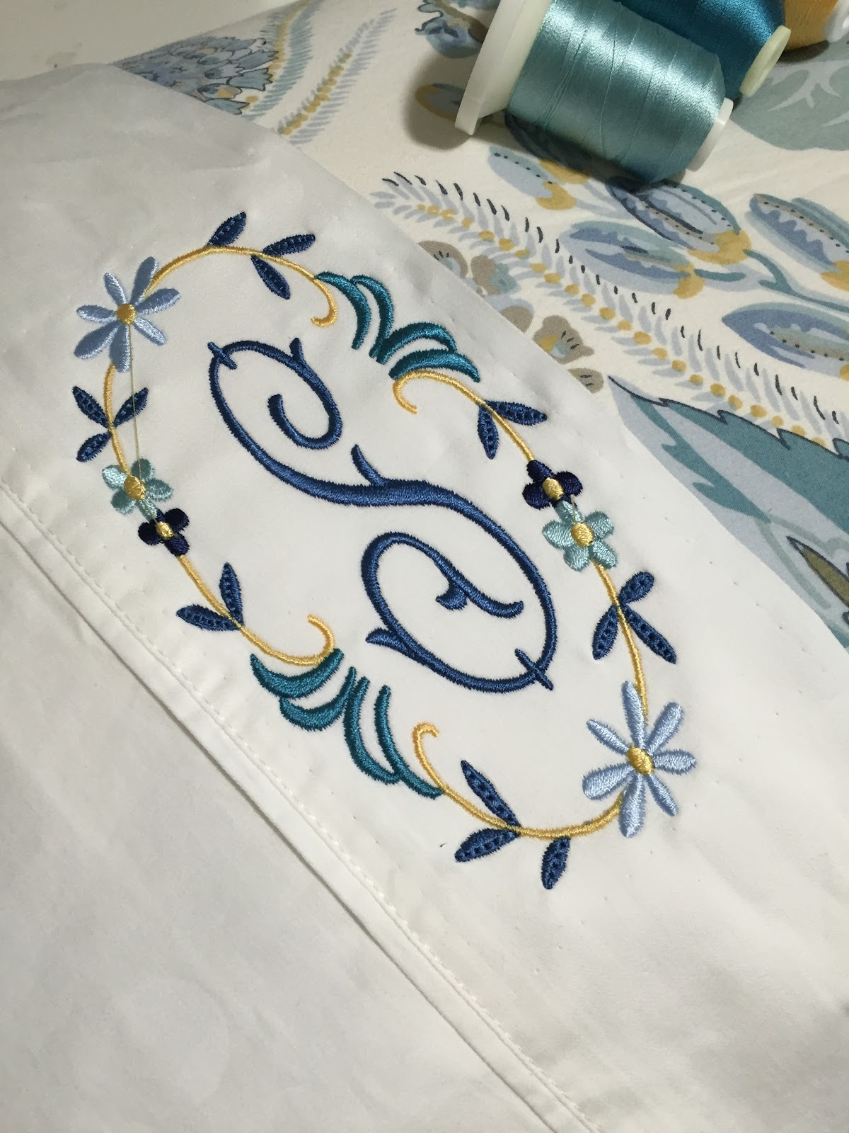 one room challenge week 4 making the bed with custom monograms after a frenzied search for a quilt or coverlet for the bed i found a beautiful one in a peacock blue color at west elm it was only about 65