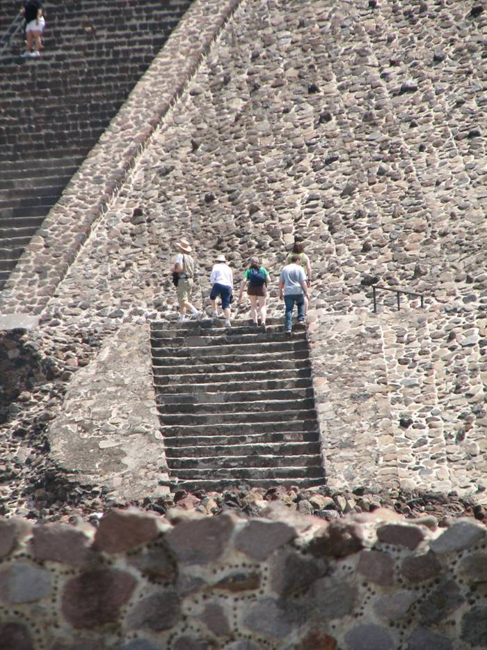 Pyramid of the Sun, It was massive, one of the first great cities of the Western Hemisphere. And its origins are a mystery. It was built by hand more than a thousand years before the swooping arrival of the Nahuatl-speaking Aztec in central Mexico. But it was the Aztec, descending on the abandoned site, no doubt falling awestruck by what they saw, who gave it a name: Teotihuacan. A famed archaeological site located fewer than 30 miles (50 kilometers) from Mexico City, Teotihuacan reached its zenith between 100 B.C. and A.D. 650. It covered 8 square miles (21 square kilometers) and supported a population of a hundred thousand, according to George Cowgill, an archaeologist at Arizona State University and a National Geographic Society grantee.