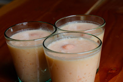 tapioca pearls with cantaloupe and coconut milk served in cups