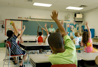 Classroom with raised hands
