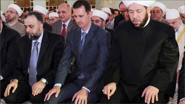 17-Syrian+President+Bashar+Al+Sad+Praying+Eid.png