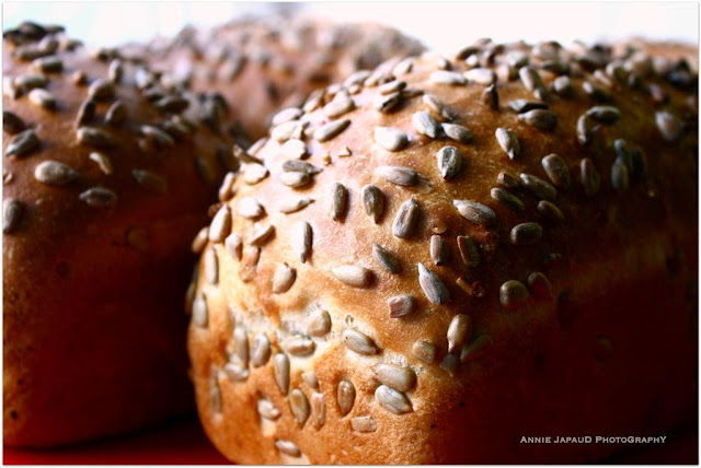 images of artisan bread rolled in sunflower seeds