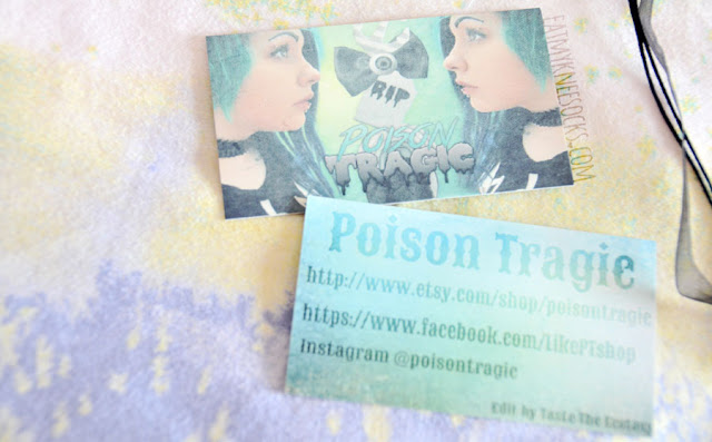 Close-up of the business cards included in my package from Poison Tragic, an Etsy shop selling unique accessories and more.