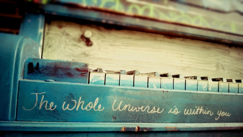 "Piano with ""The Whole Universe is Within You"" written on it"