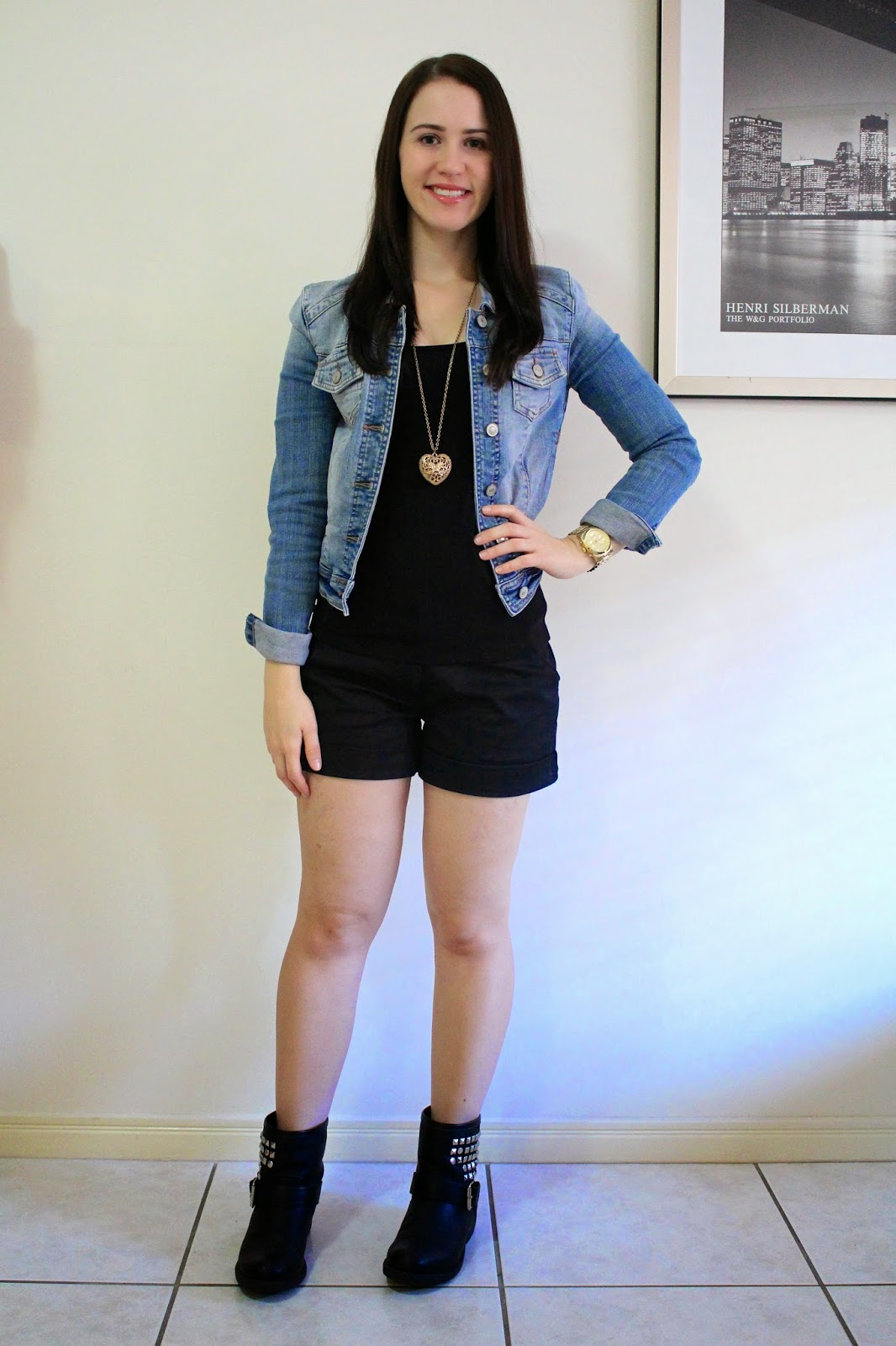Black tailored shorts, black singlet, black studded biker boots, denim jacket, gold michael kors watch, gold heart long necklace, everyday outfit, petite outfit, fall outfit, autumn outfit, spring outfit, all black outfit, college outfit, uni outfit