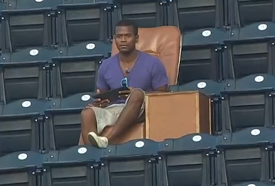 Padres fan lounges out in leather chair