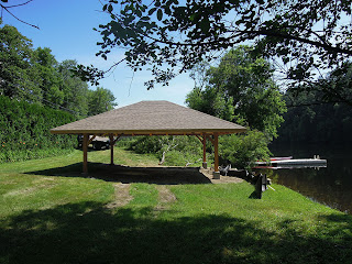 this new timber frame pavilion boathouse is located along the connecticut river