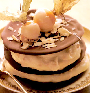 Chocolate hazelnut galettes: Classic french dessert of chocolate rounds sandwiched with fromage frais and ground hazelnuts topped with a white chocolate dipped physalis.