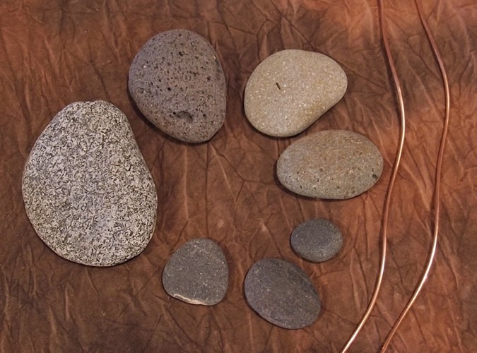 Beach stones and copper wire.