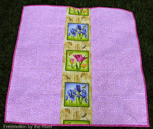 Back of quilt with panel strip Freemotion by the River
