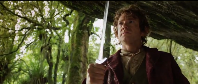 The Hobbit An Unexpected Journey 2012 film prequel Bilbo Baggins holding the Elvish Knife Sting Frodo's Sword thta glows blue when Orcs are near by on the Lord of the Rings Film Trilogy later on