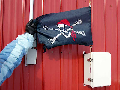 The Skull and Crossbones. I don't imagine that this flag leaves the port.