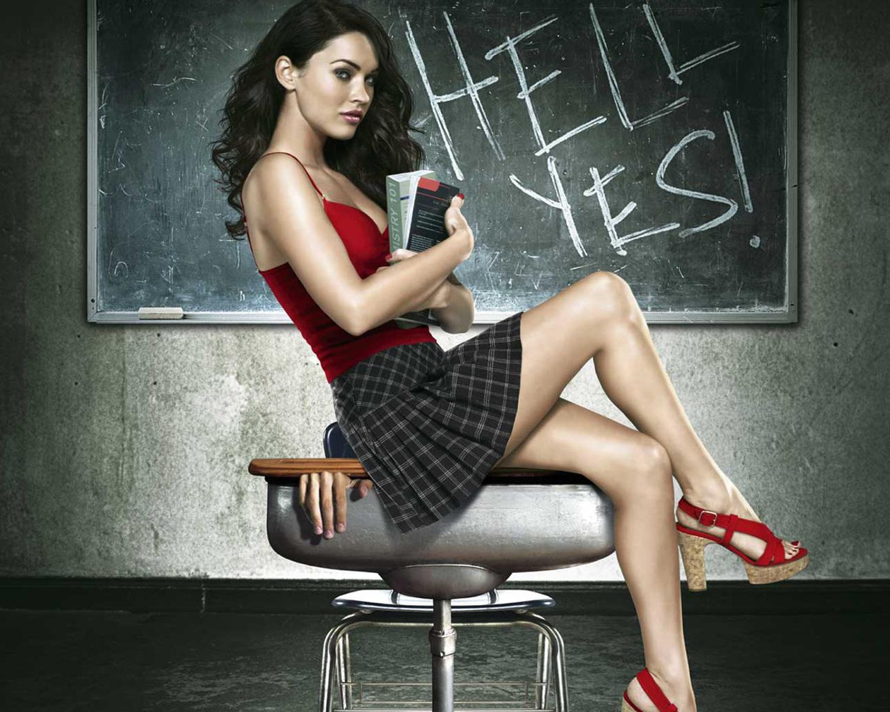 Megan Fox Sitting on Chair in Red & Black Dress 1