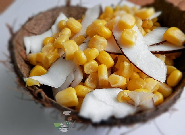 Nigerian street snack boiled corn and shaved coconut boiled corn and coconut are one of those nigerian street snacks we call a match made in heaven it is usually sold by street hawkers but you can easily forumfinder Images