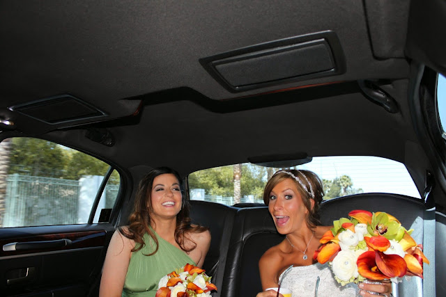 Leyla and Katie laughing in car on Katie's wedding day