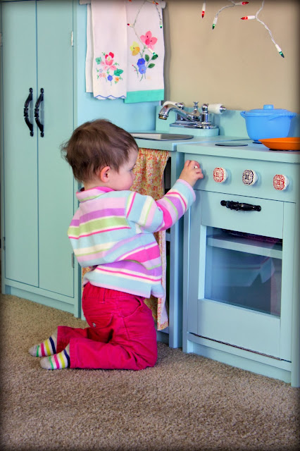 Baby Playing with Play Kitchen
