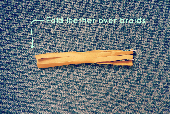 Fold leather over braids