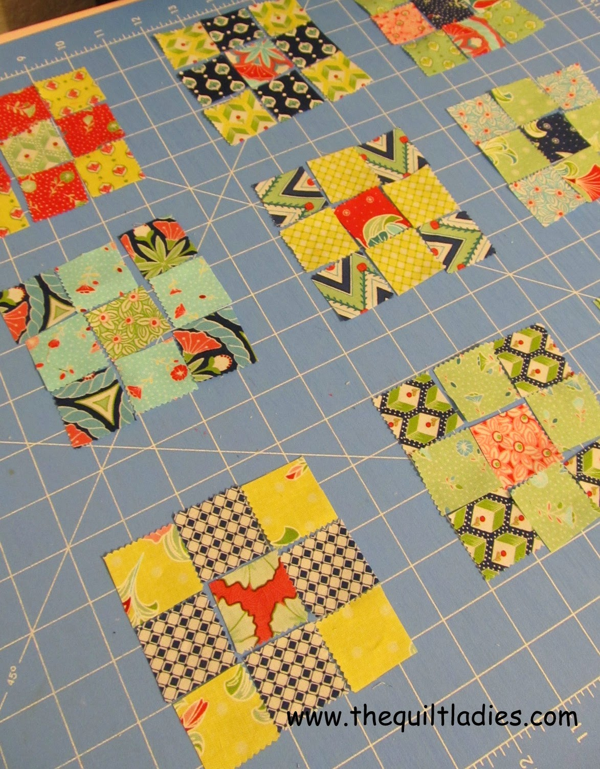 Nine-patch quilted table topper tutorial by The Quilt Ladies