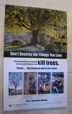 Poster telling people not to move fire wood across state lines