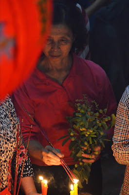 Woman. Lunar New Year at Wat Phnom, Phnom Penh, Cambodia