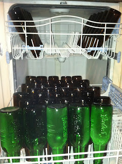 Beer bottles being sanitized in dishwasher