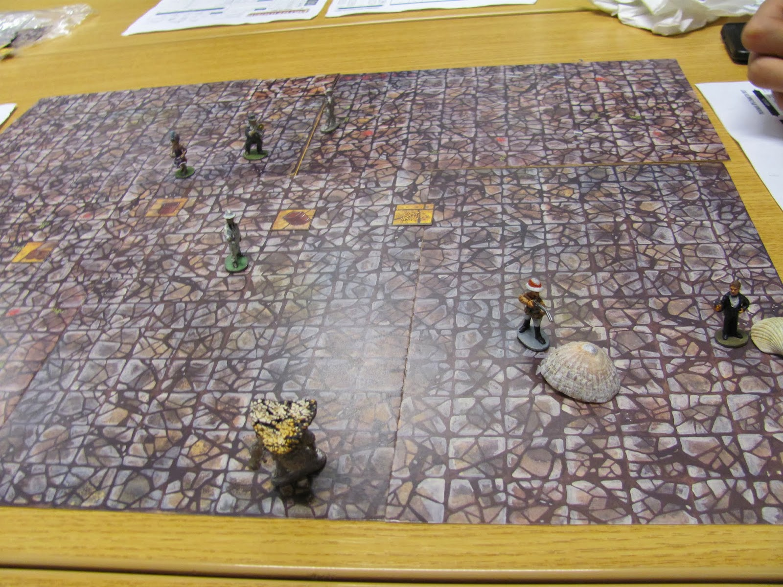 An RPG battle map with player characters and enemies