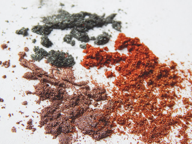 Colorful glitter scattered on a white background