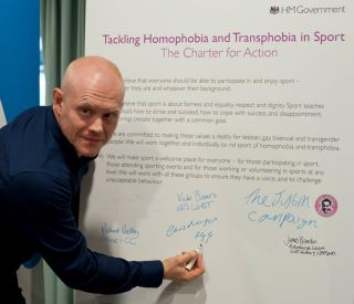 Gay Games Ambassador Chris Morgan signs the UK Charter Against Homophobia in ...