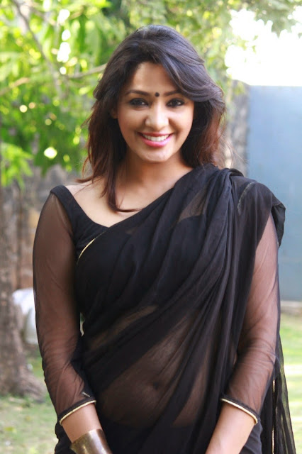 Actress Samruthika  Picture Gallery in Black Saree at Aayirathil Iruvar Movie Press Meet CelebsNext 14.JPG
