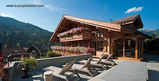 Casa chalé en los Alpes de Suiza hecha de madera y aspecto tradicional