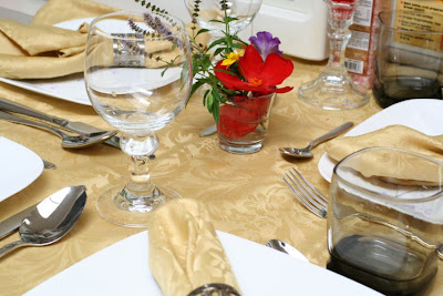 Fancy dinner at our house (no occasion :) ): golden table cloth and matching napkins set, flowers, wine goblets, silverware and good disposition :: All Pretty Things