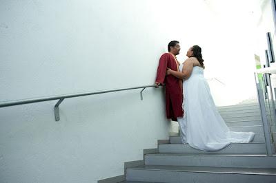 Tameka and Manoj on the stairs of the Bellevue Art Museum