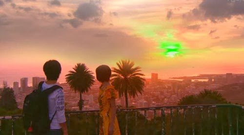 Nakahara and Misaki look at the green sunset from Punchbowl Crater.