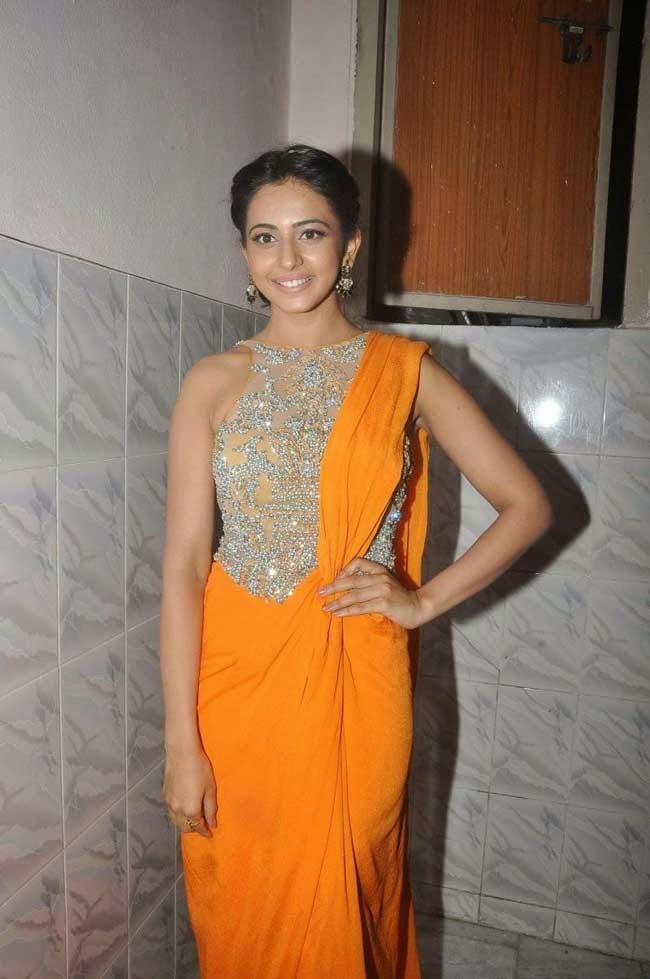 Rakul Preet Singh In Orange Saree Gown
