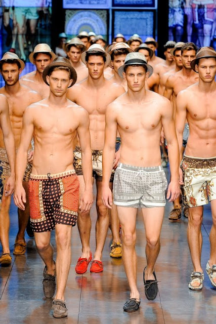 a horde of shirtless male models