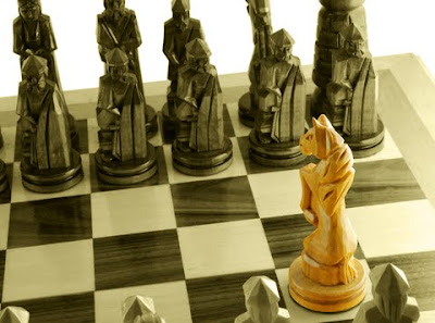 Picture:  Chessmen on a board, but one standing out as distinctive