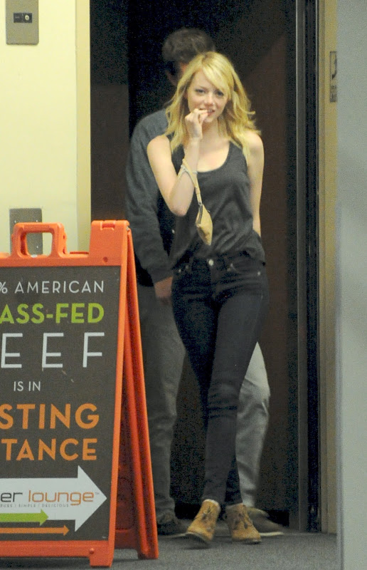 Emma Stone Leaving a restaurant with a tooth pick in her mouth