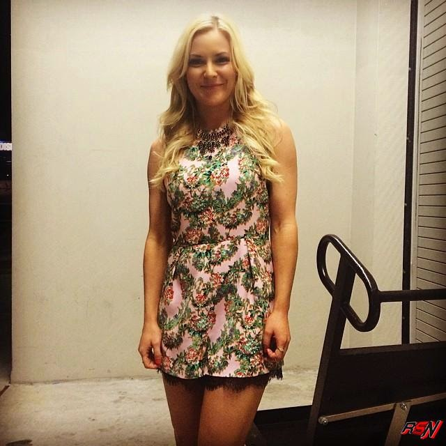 Renee Young Smiles for the Camera.