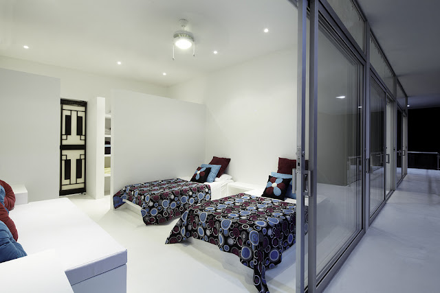 White modern bedroom with two single beds