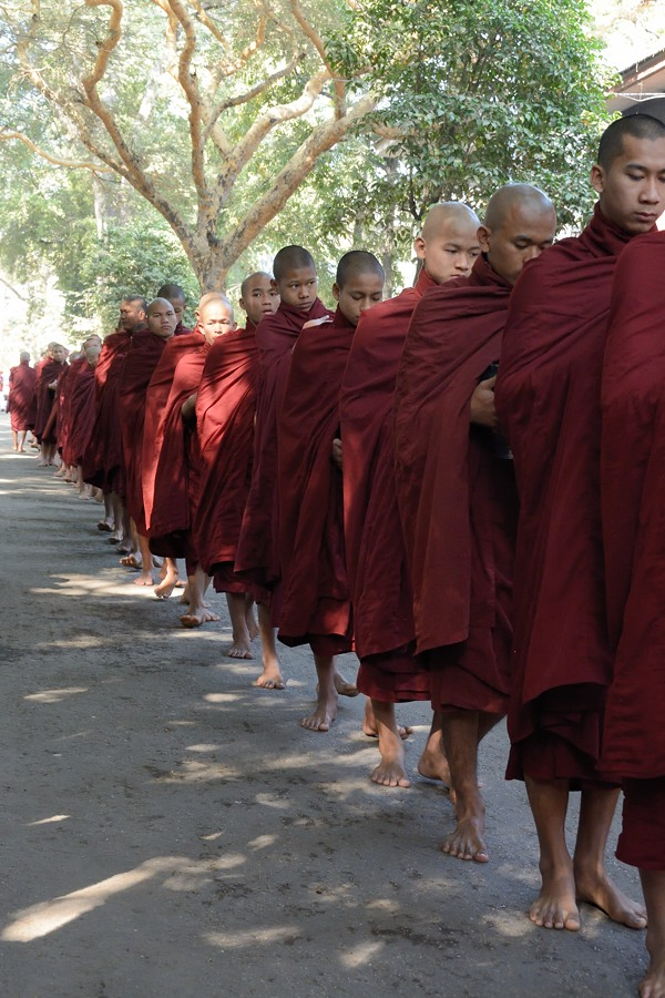 Monks at Mahagandayon Monastery line up for their meal.