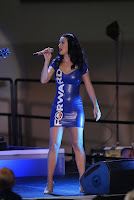 Katy Perry on stage in tight blue dress
