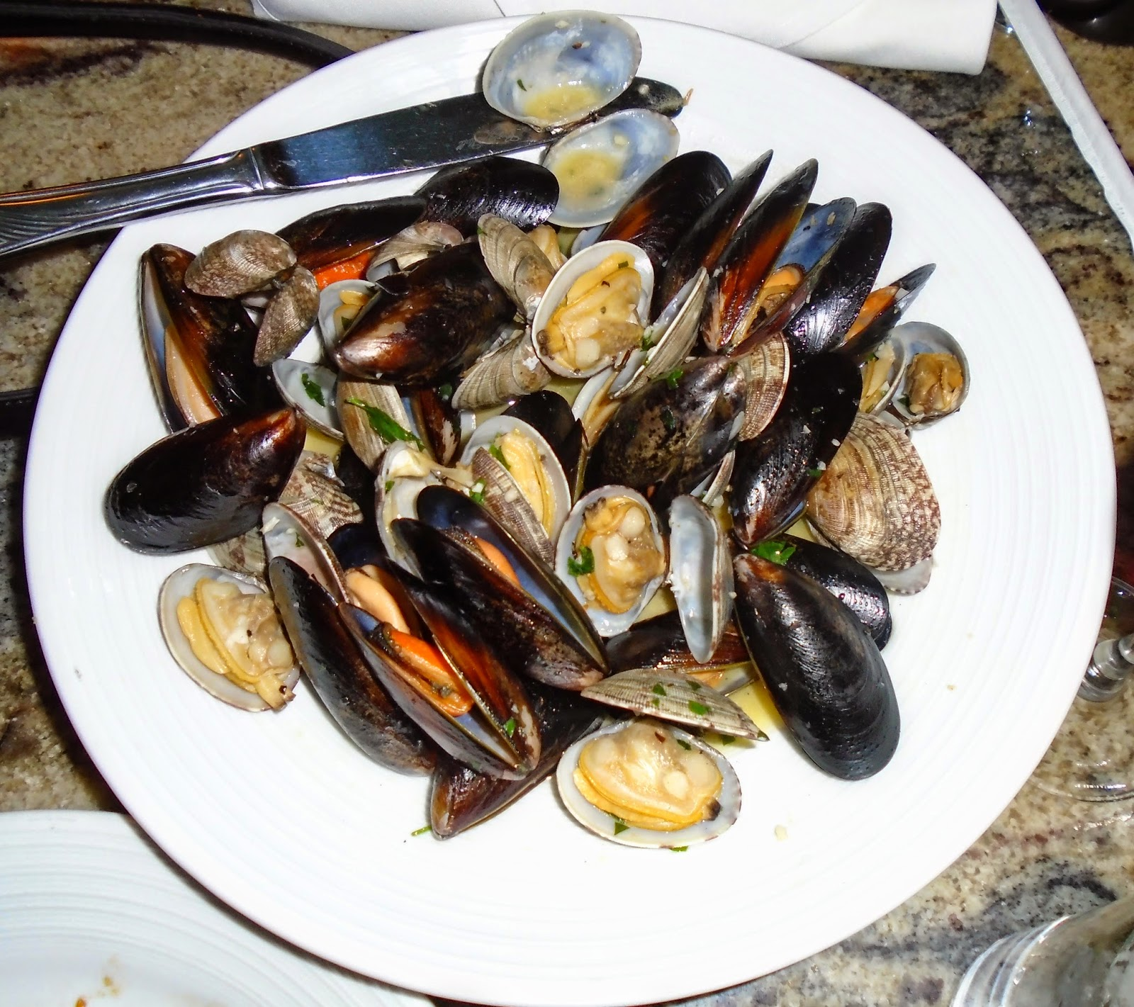 A close-up of the tender, juicy mussels and clams